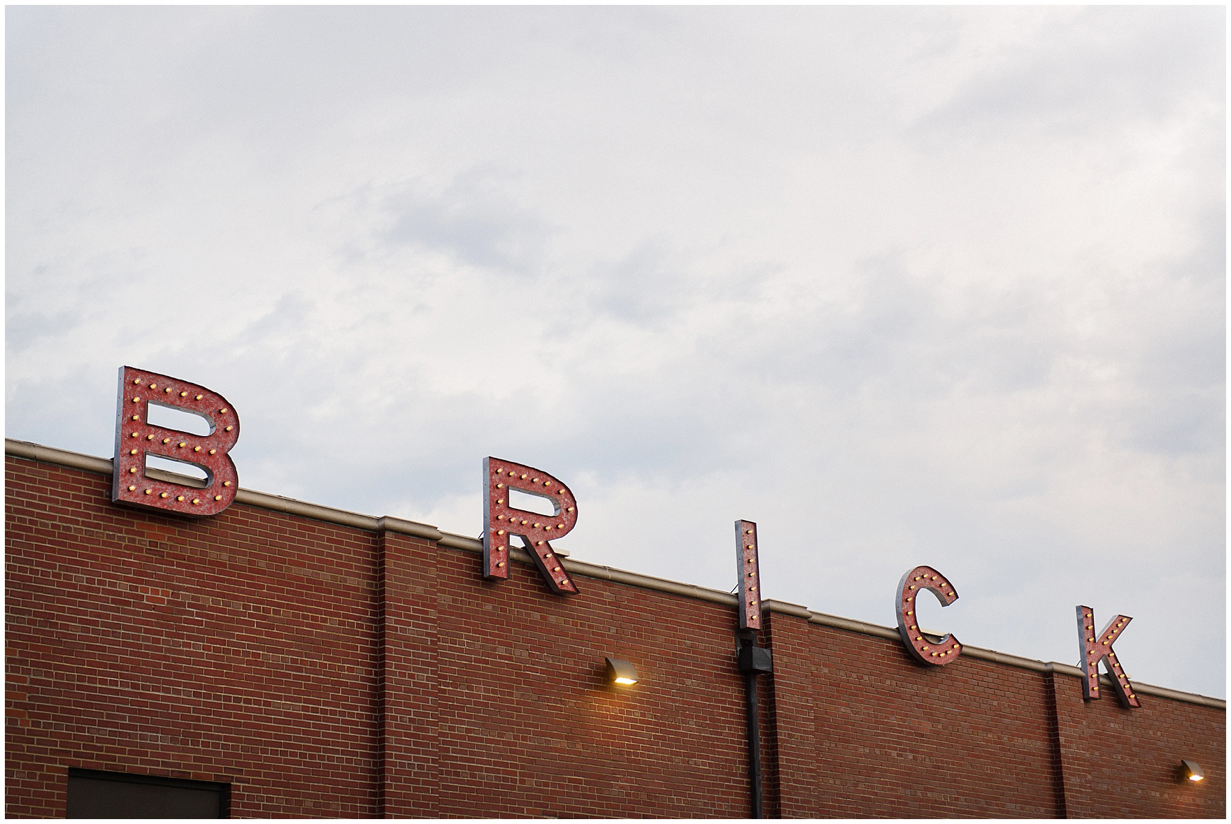 Exterior sign at The Brick in South Bend, following a University of Notre Dame wedding.