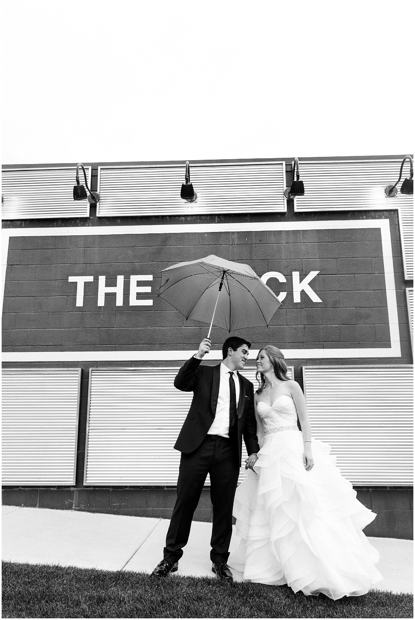The bride and groom pose in front of The Brick in South Bend, site of their reception following a University of Notre Dame wedding.