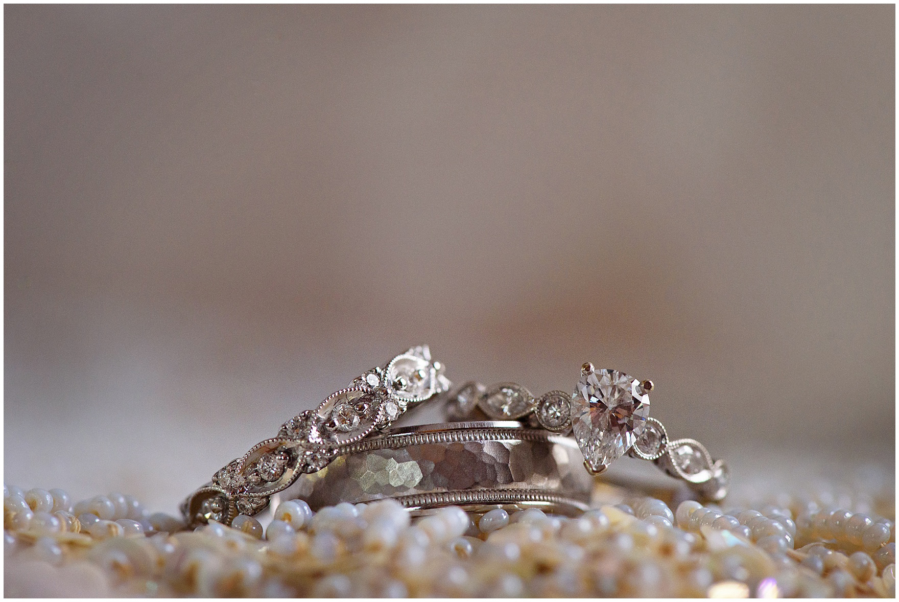 Macro photography of wedding bands and engagement ring for a St. Francis Xavier and Brookfield Zoo Chicago wedding.