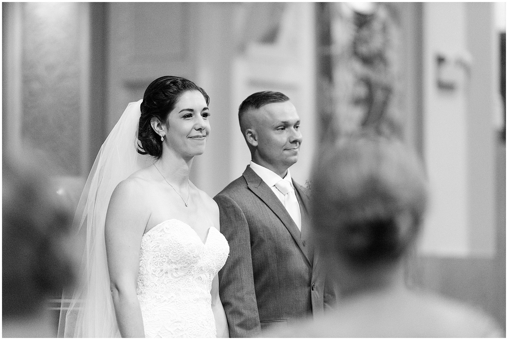 The bride and groom after saying their vows at a St. Francis Xavier and Brookfield Zoo Chicago wedding.
