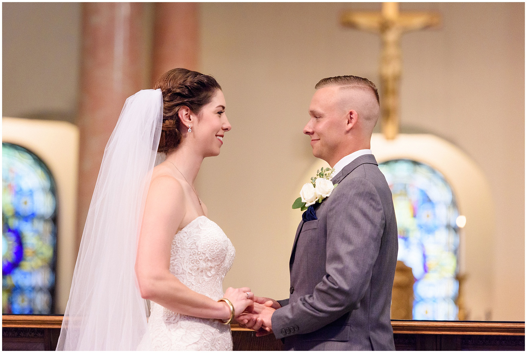 The bride and groom exchange rings at a St. Francis Xavier and Brookfield Zoo Chicago wedding.