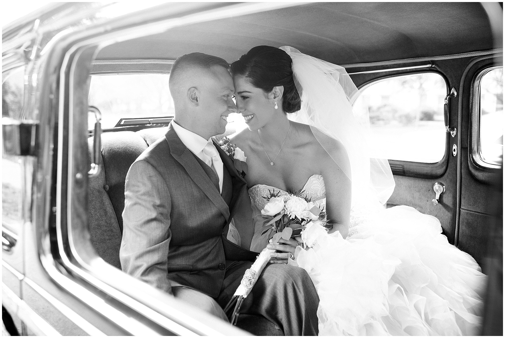The bride and groom depart in a limo at a St. Francis Xavier and Brookfield Zoo Chicago wedding.