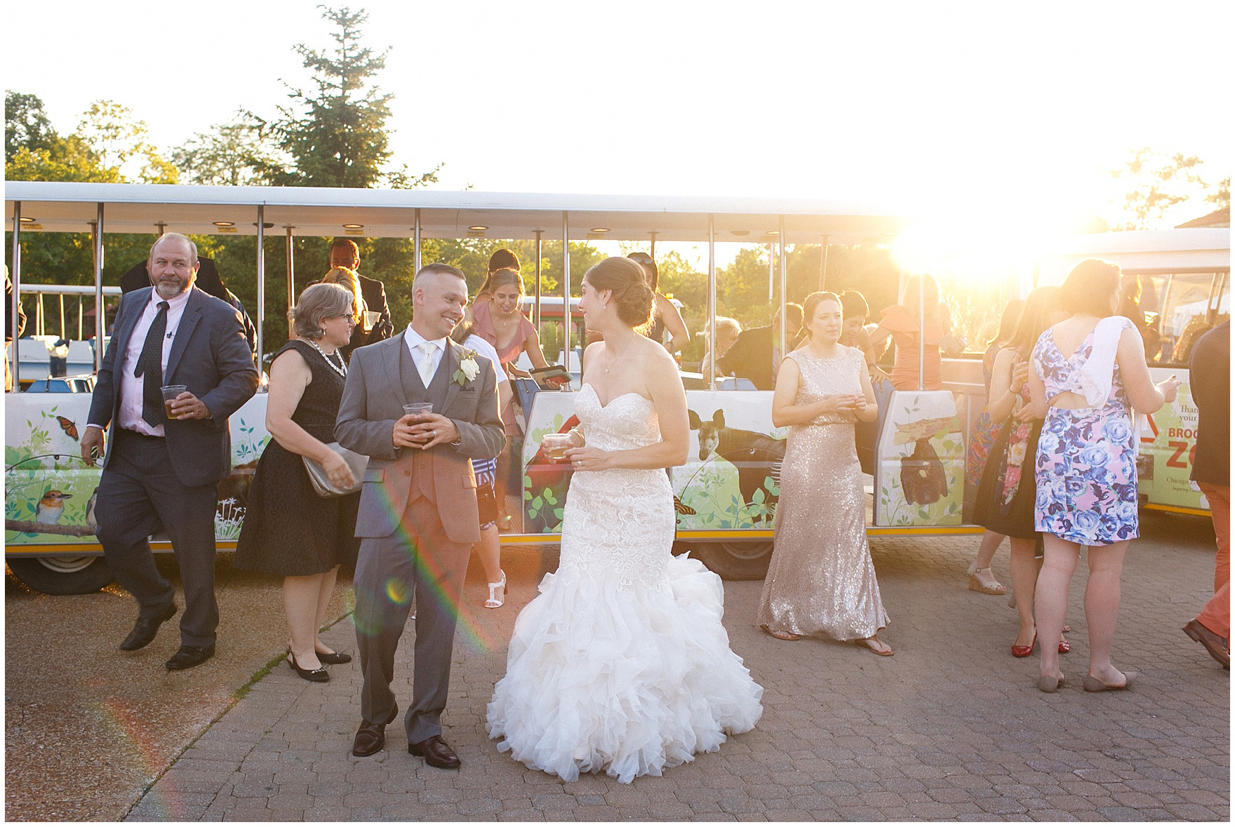 Guests ride the tram to the reception at a St. Francis Xavier and Brookfield Zoo Chicago wedding.