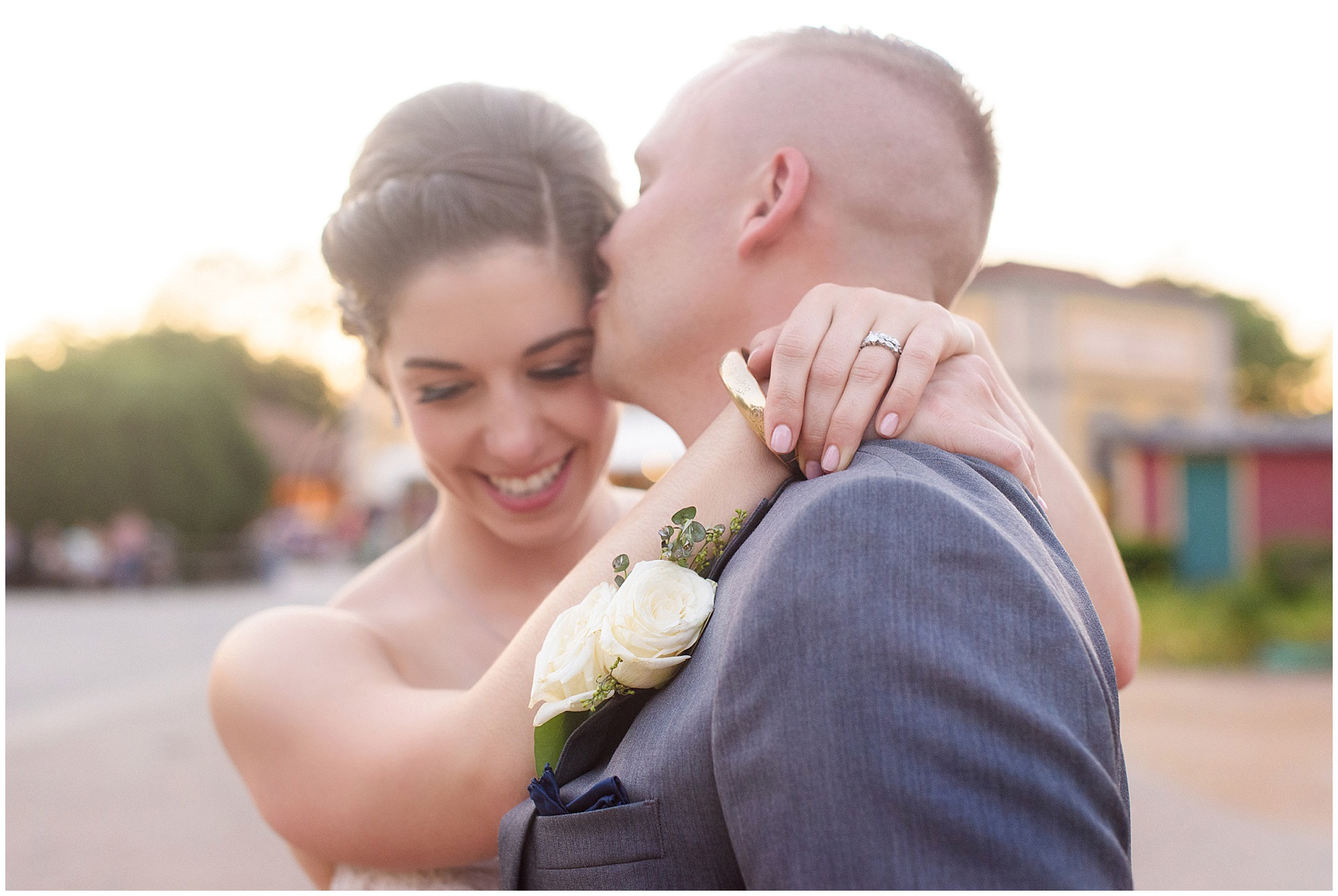 The bride and groom embrace at sunset at a St. Francis Xavier and Brookfield Zoo Chicago wedding.