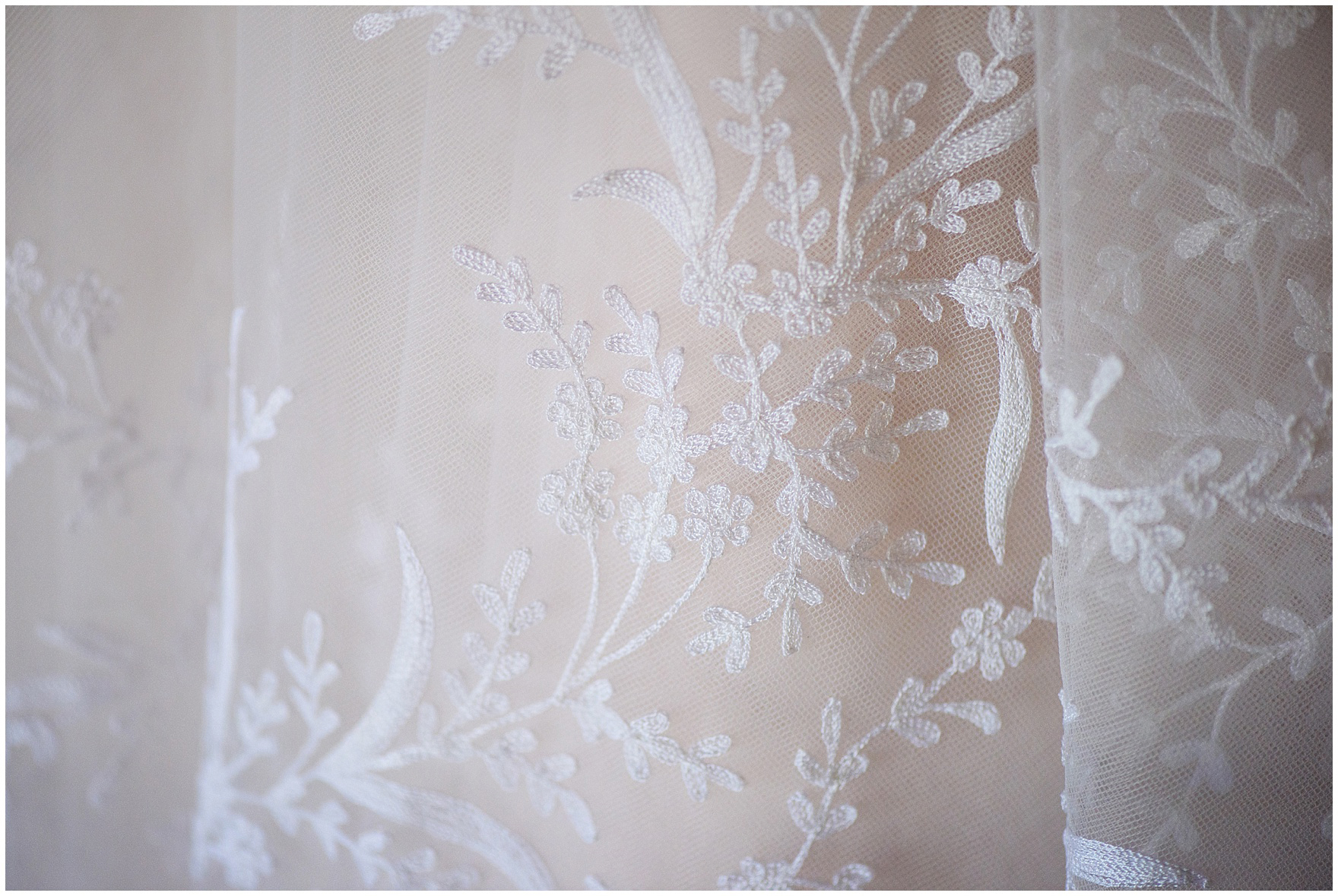 Detail of embroidery on a tulle skirt of a wedding dress for a Butterfield Country Club wedding.