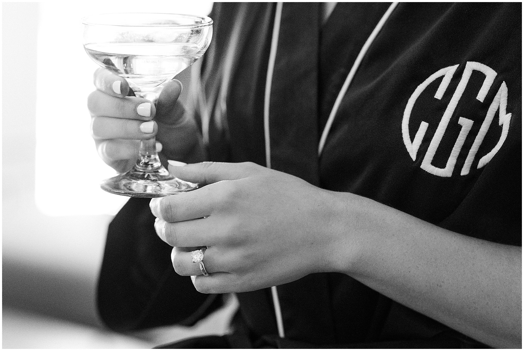 A bride drinks champagne as she gets ready for a Butterfield Country Club wedding.