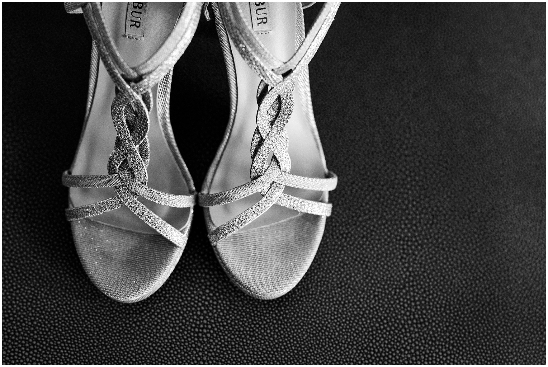 Detail shot of the brides strappy silver heels for a Butterfield Country Club wedding.