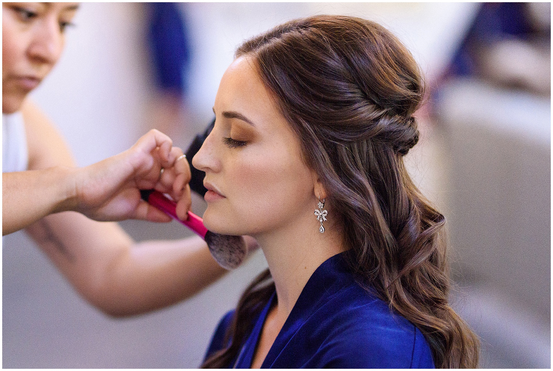 The bride gets her makeup done for a Butterfield Country Club wedding.