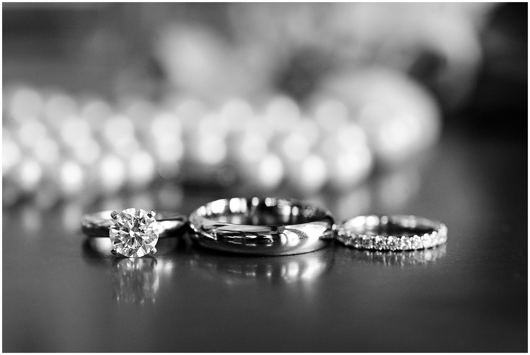 A close up photograph of wedding bands and an engagement ring for a Butterfield Country Club wedding.