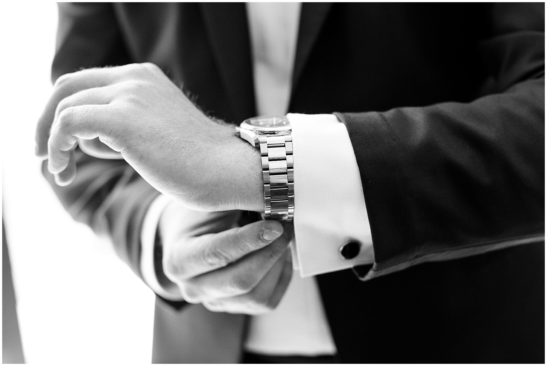 The groom adjusts his watch before a Butterfield Country Club wedding.