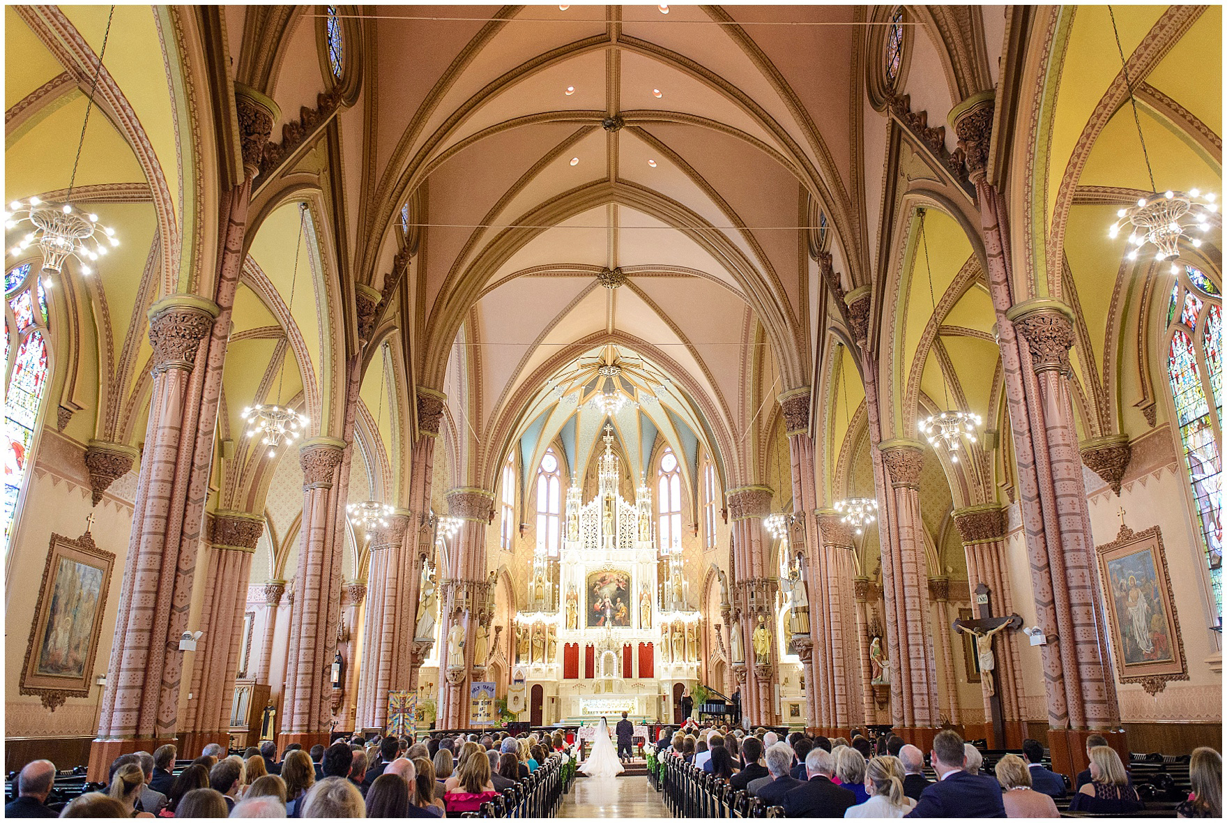 The bride and groom kneel in Chicago's historic Holy Family Church, site of the ceremony for a Butterfield Country Club wedding.
