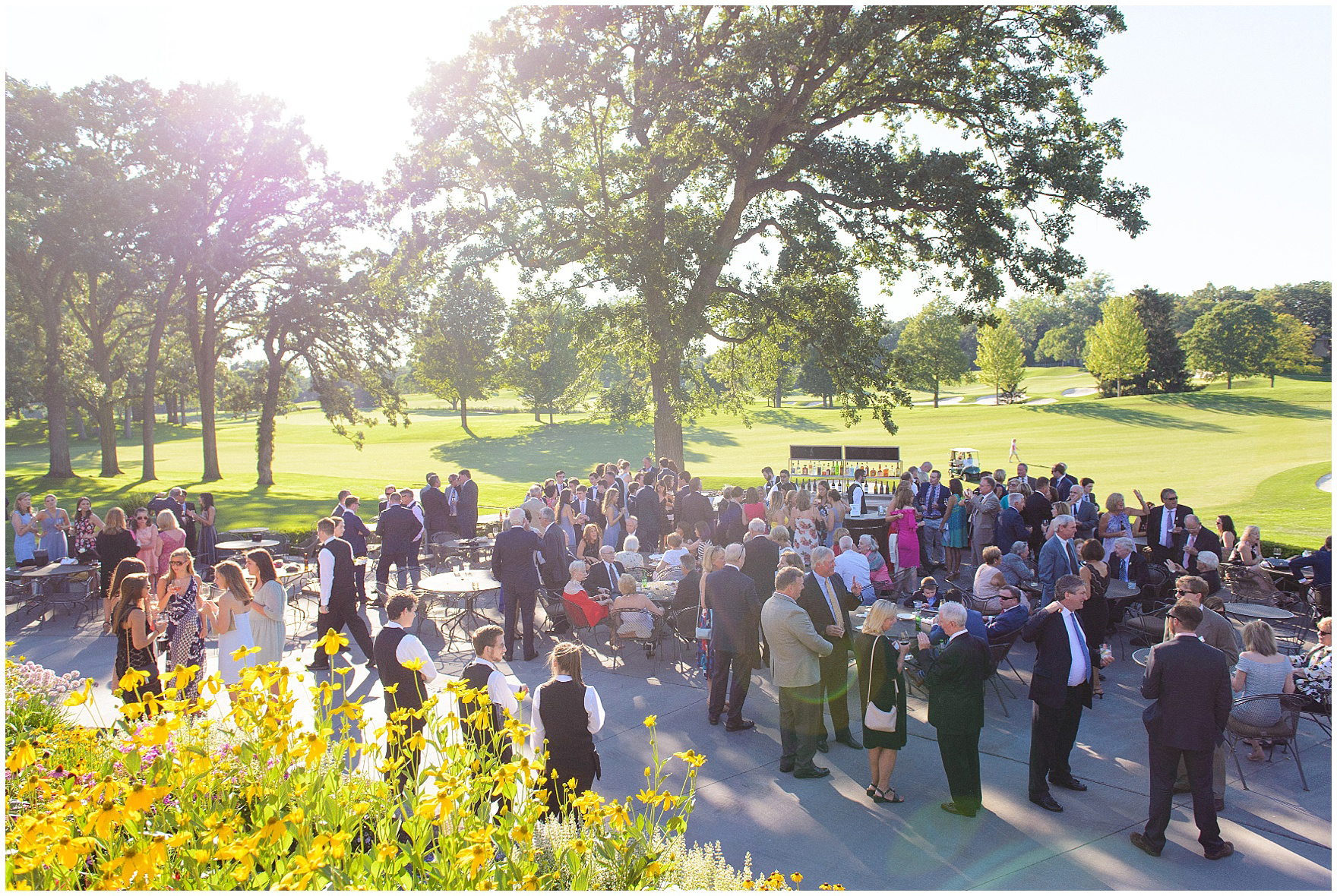 Guest mingle during a Butterfield Country Club wedding.