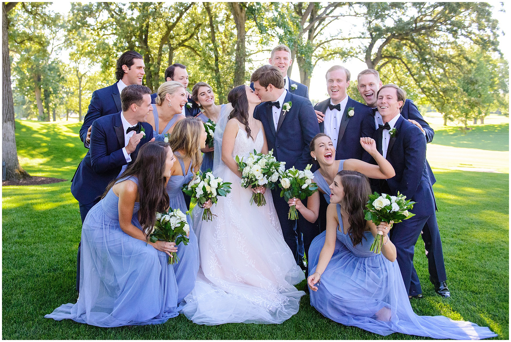 The bridal party poses during a Butterfield Country Club wedding.