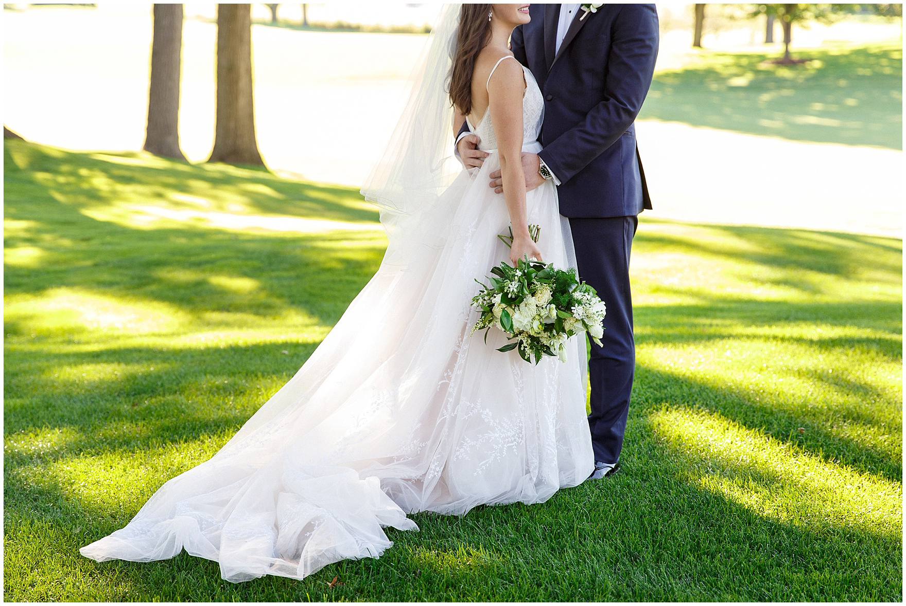 The bride and groom embrace during a Butterfield Country Club wedding.