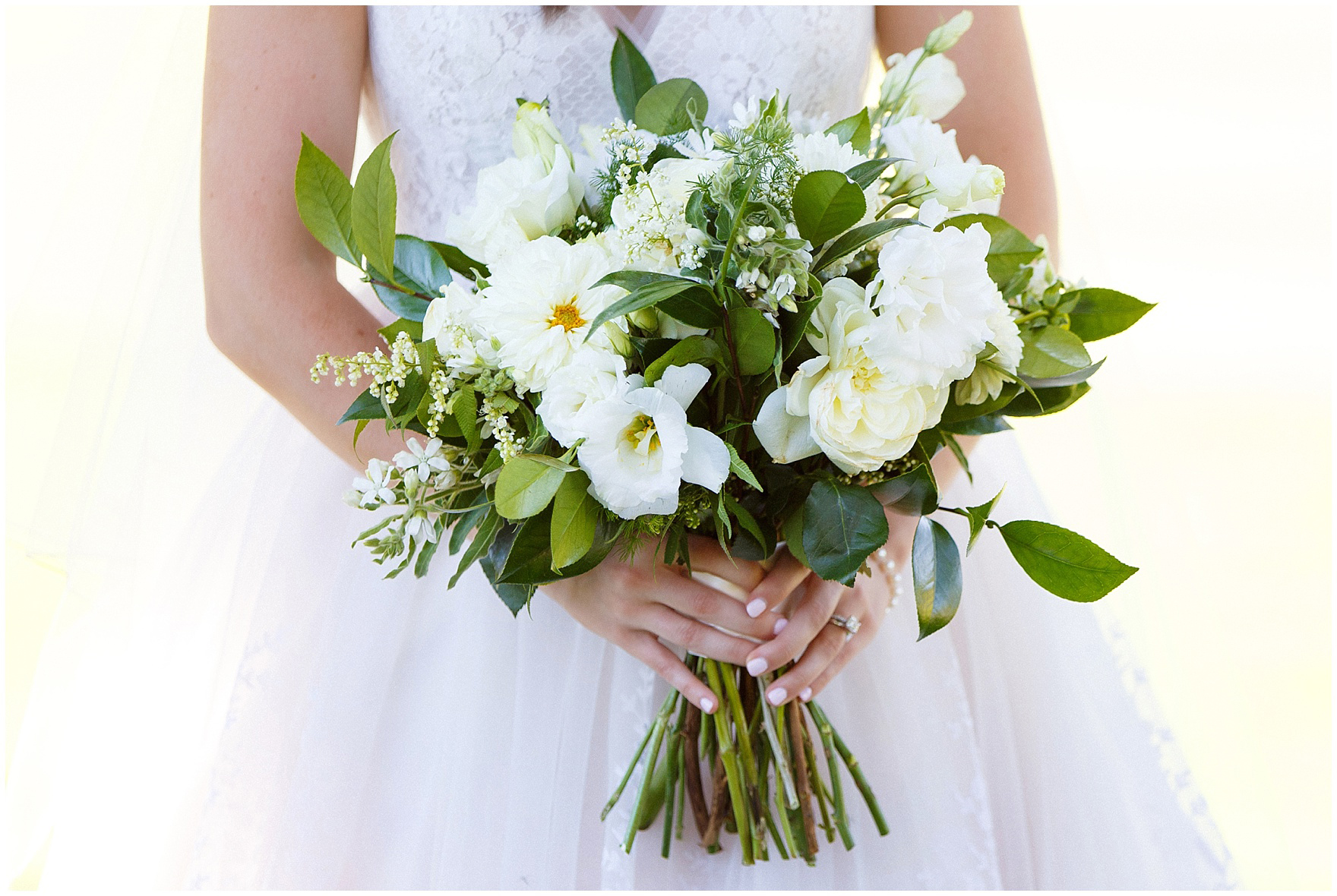 Detail of a bridal bouquet by Flowers for Dreams during a Butterfield Country Club wedding.