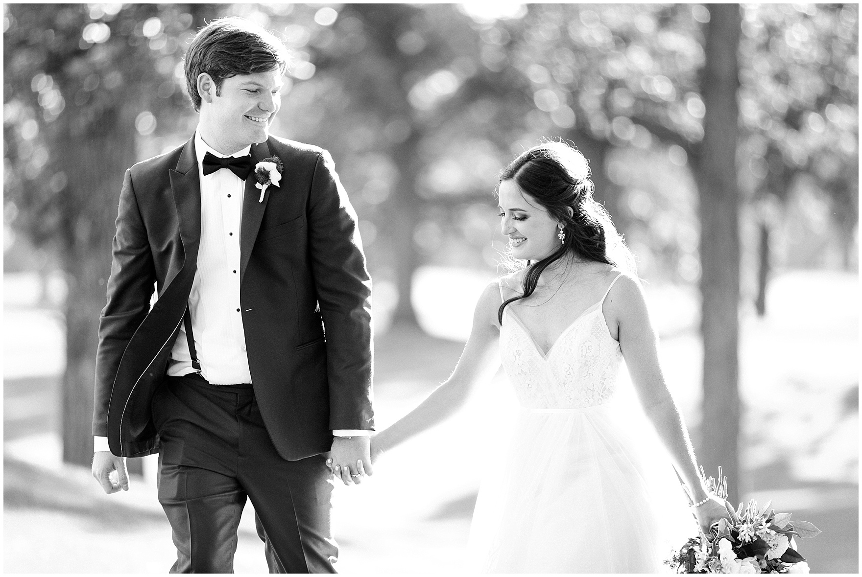The bride and groom walk together during a Butterfield Country Club wedding.