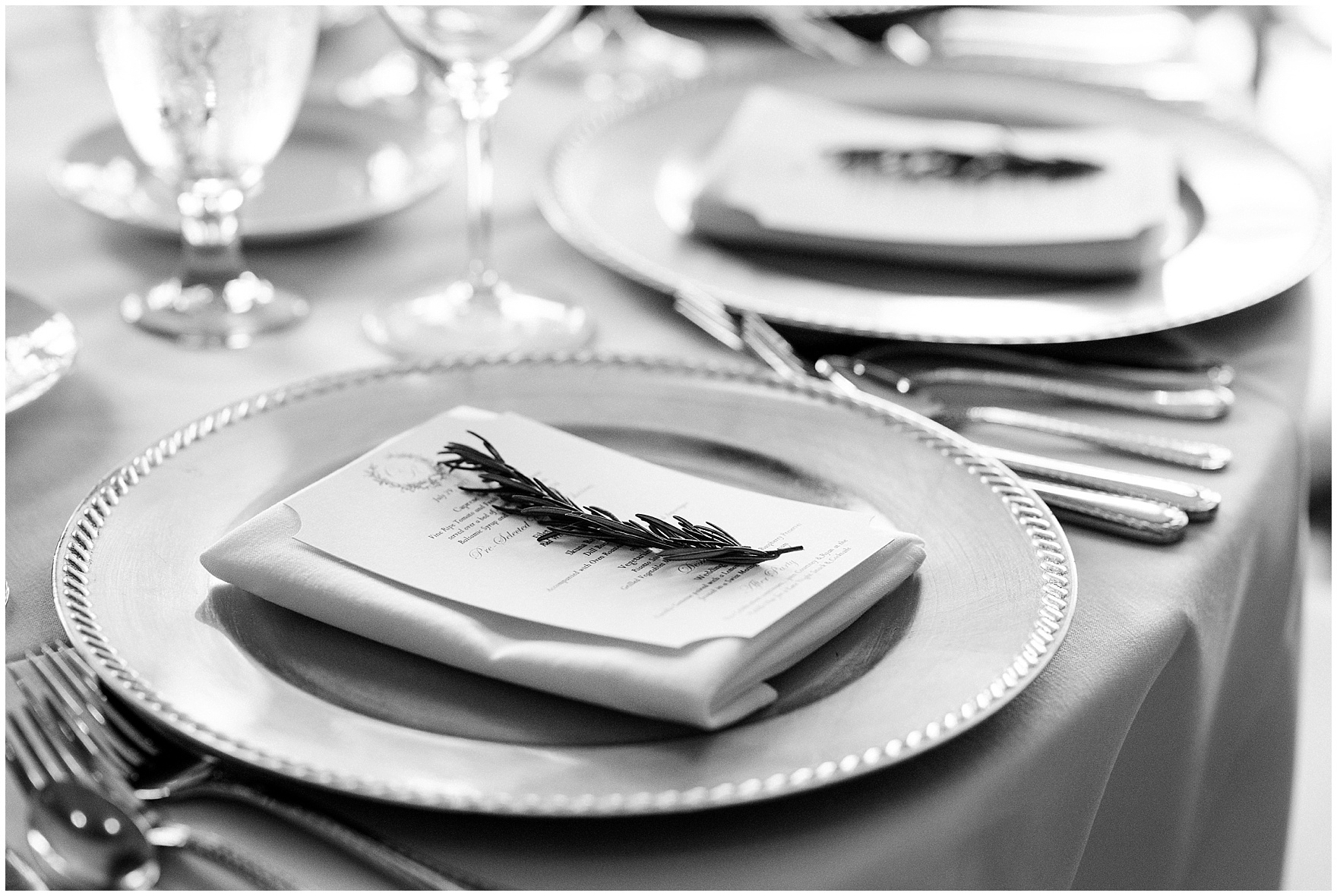 Menus are adorned with sprigs of rosemary during a Butterfield Country Club wedding.