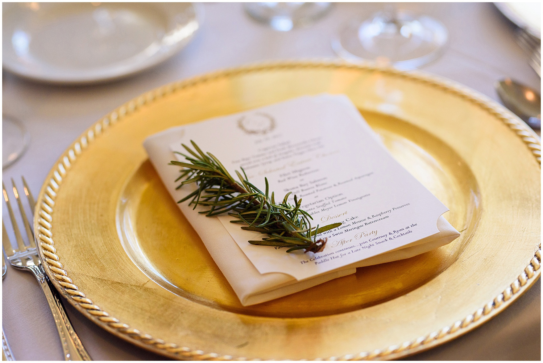 Menus on gold chargers are adorned with sprigs of rosemary during a Butterfield Country Club wedding.