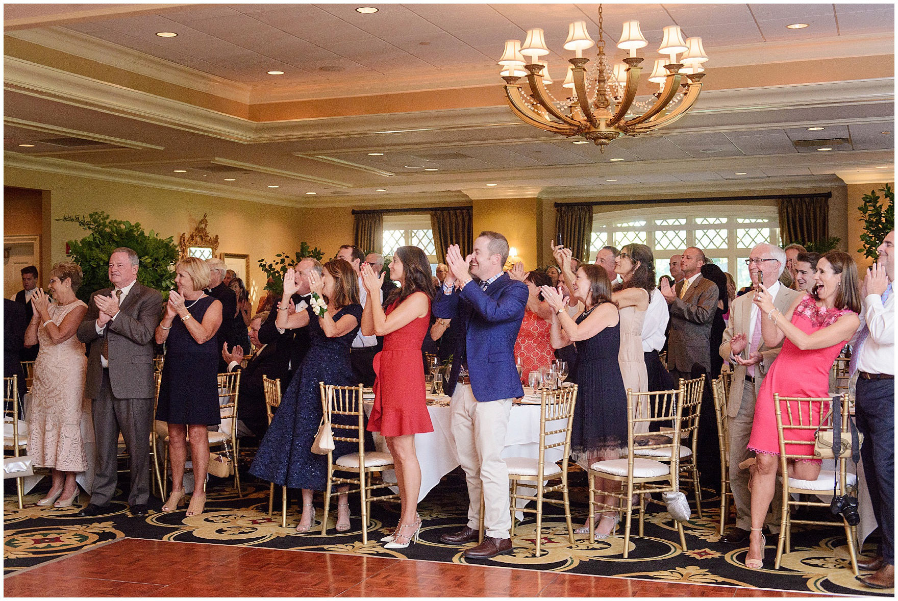 Guests applaud during a Butterfield Country Club wedding.