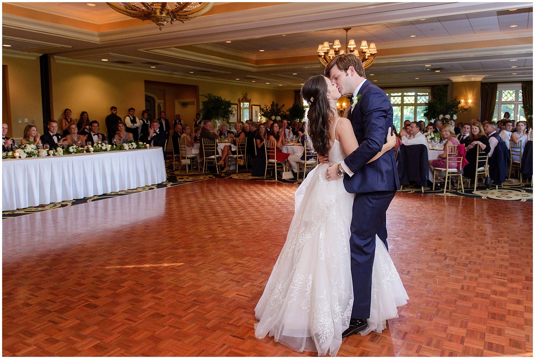 The bride and groom share their first dance during a Butterfield Country Club wedding.
