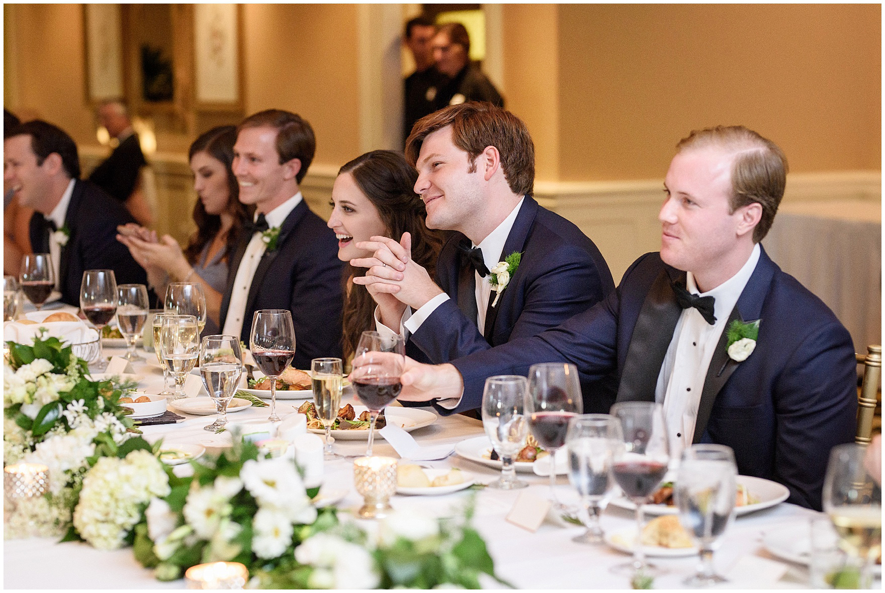 The bride and groom laugh during toasts at their Butterfield Country Club wedding.