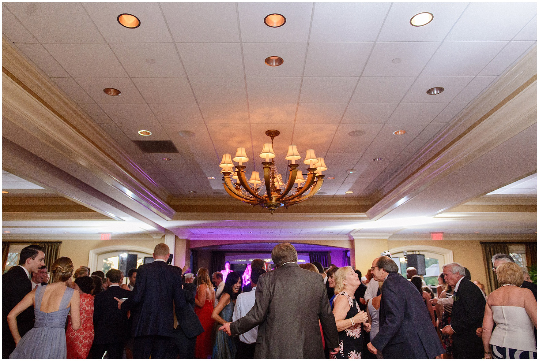 Guests dance to a live band at a Butterfield Country Club wedding.