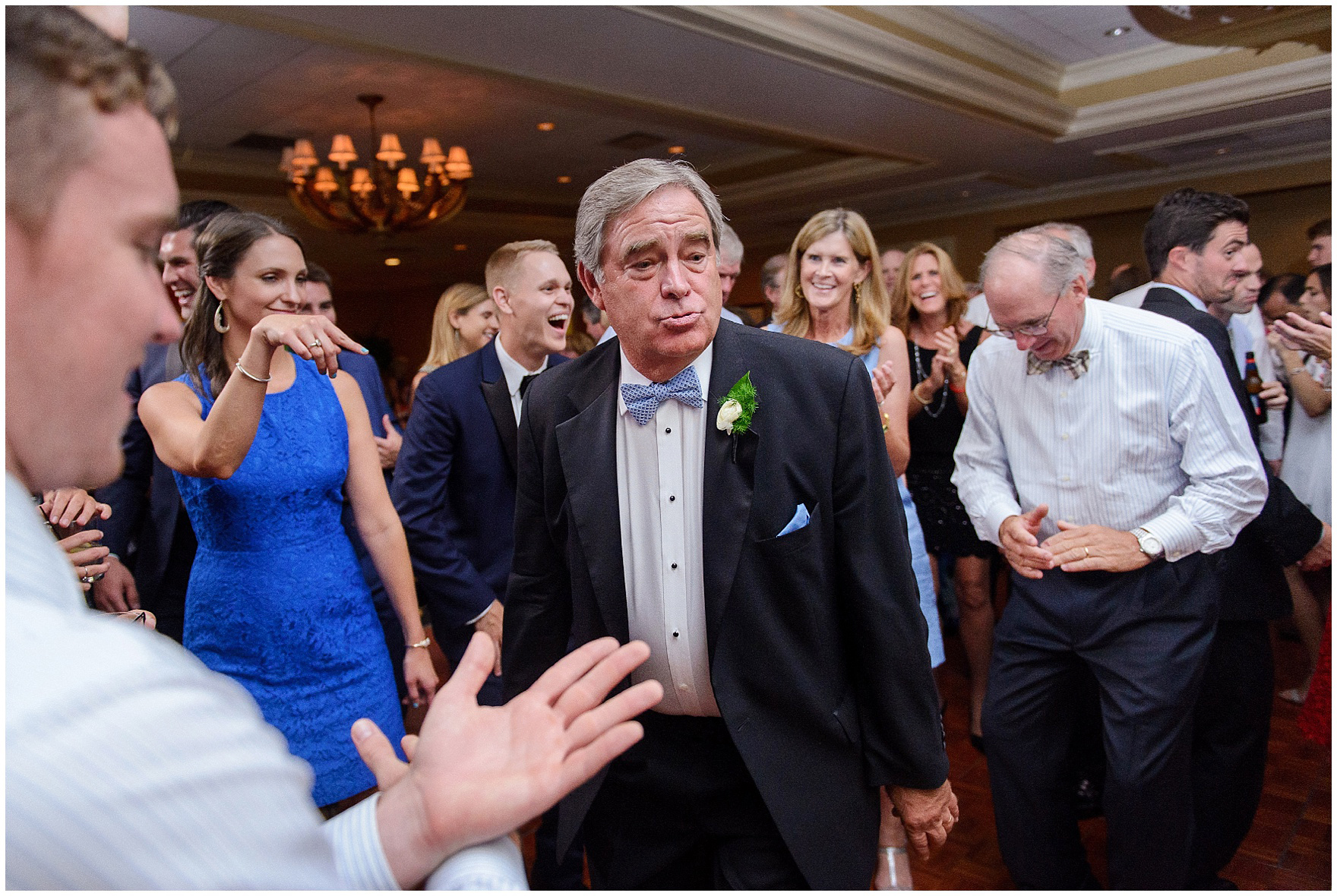 Guests dance at a Butterfield Country Club wedding.