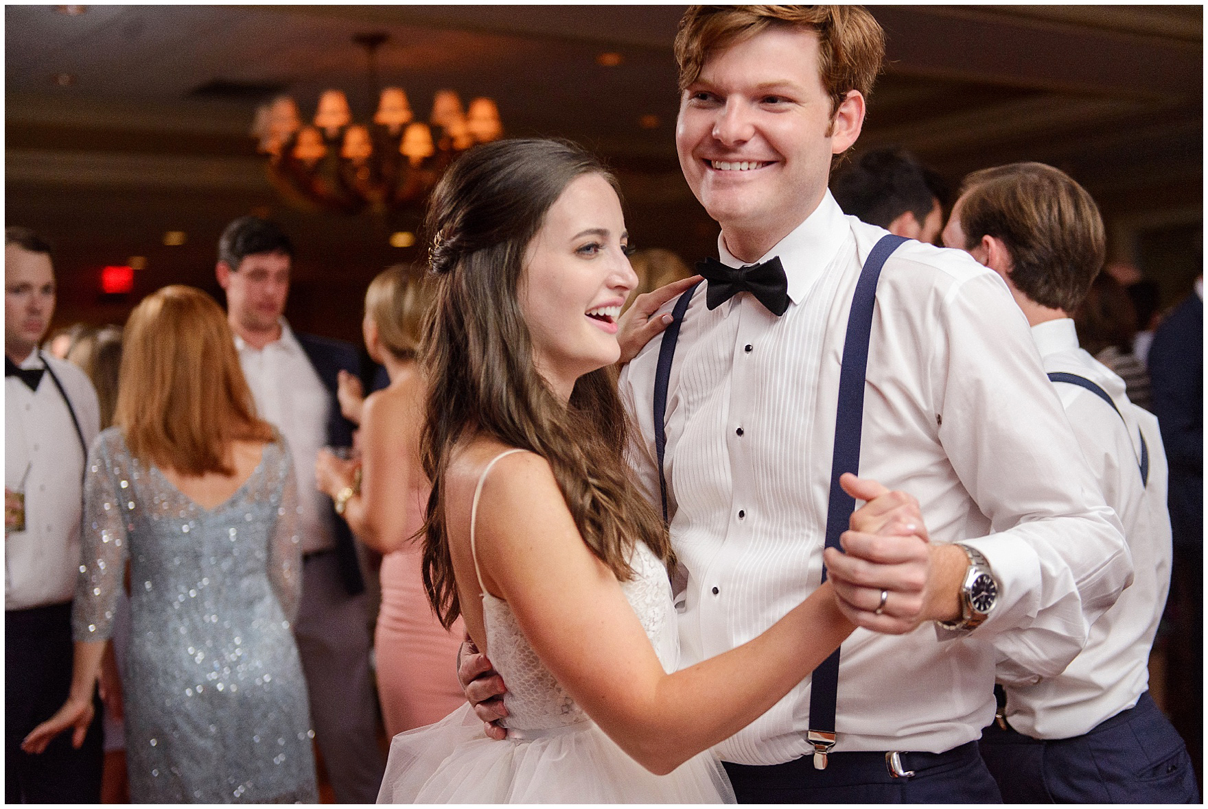 The bride and groom dance at a Butterfield Country Club wedding.