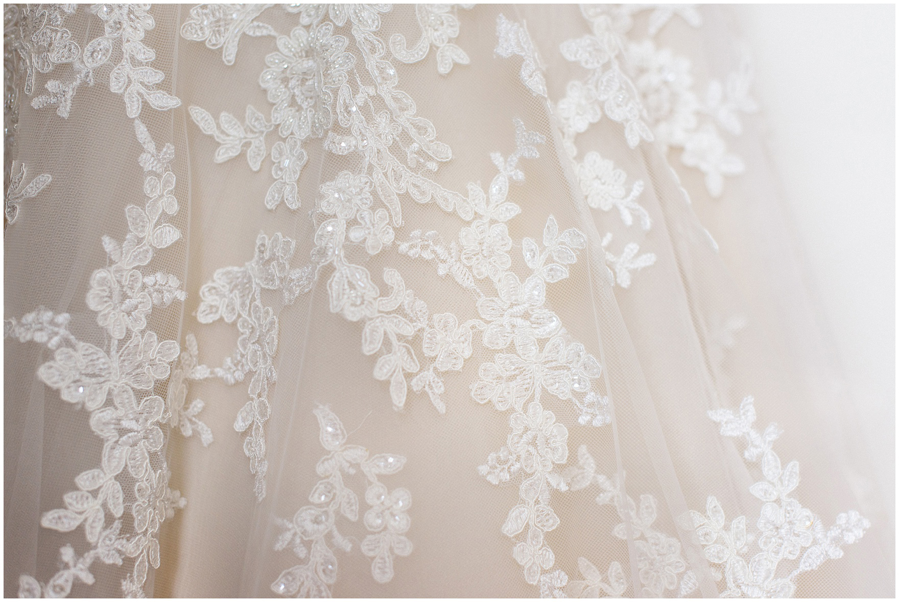 Details of a lace and tulle wedding gown for a Hotel Arista Naperville wedding.