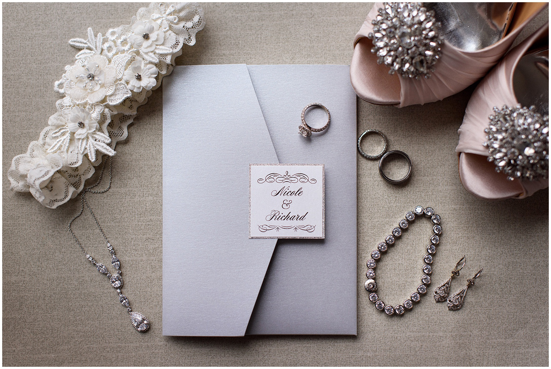 Details of the wedding invitation with the bride's accessories and jewelry for a Hotel Arista Naperville wedding.