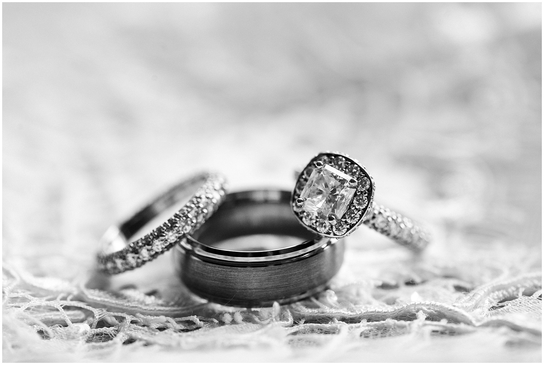 Detail of the engagement ring and wedding bands for a Hotel Arista Naperville wedding.