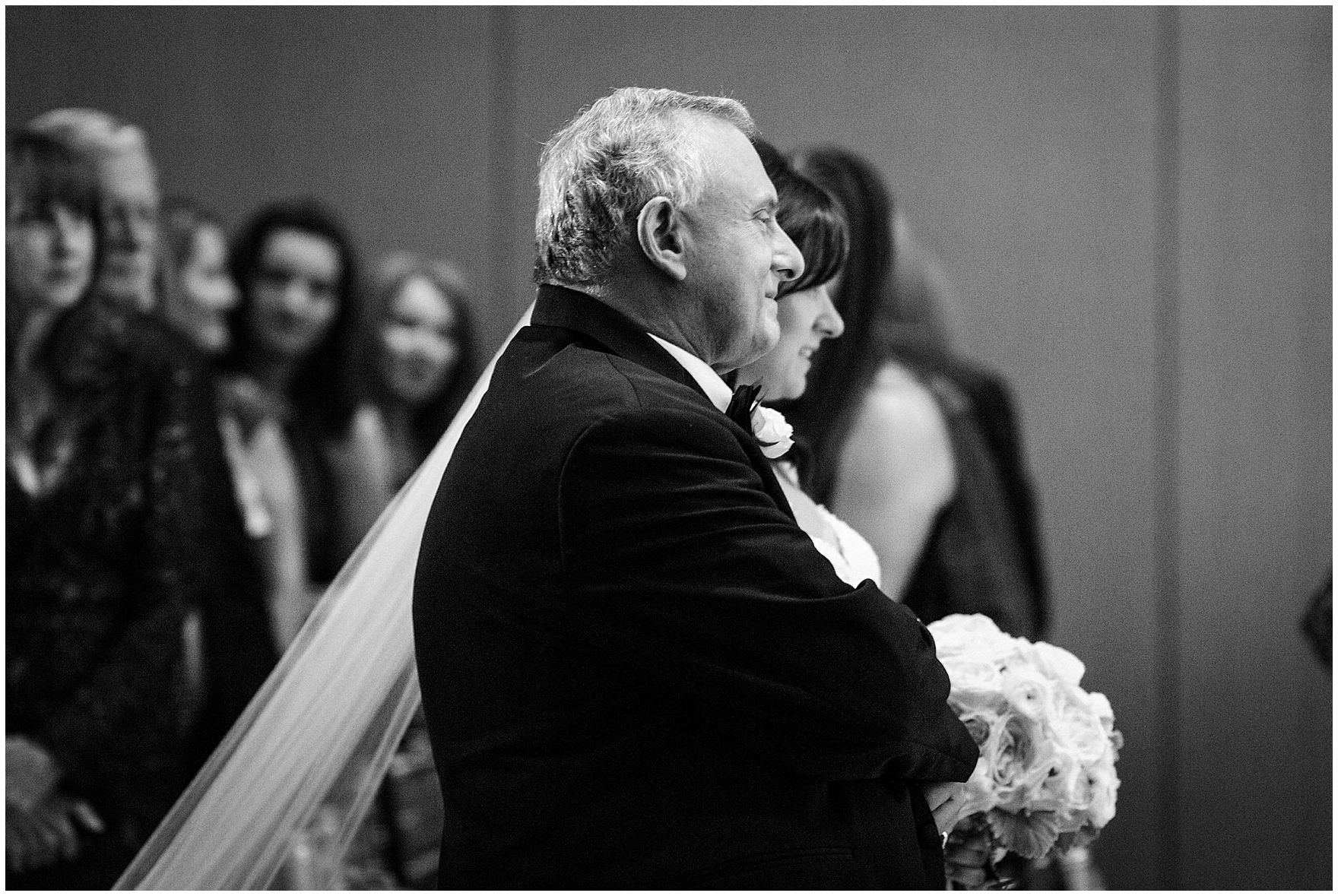 The bride walks down the aisle for a Hotel Arista Naperville wedding.