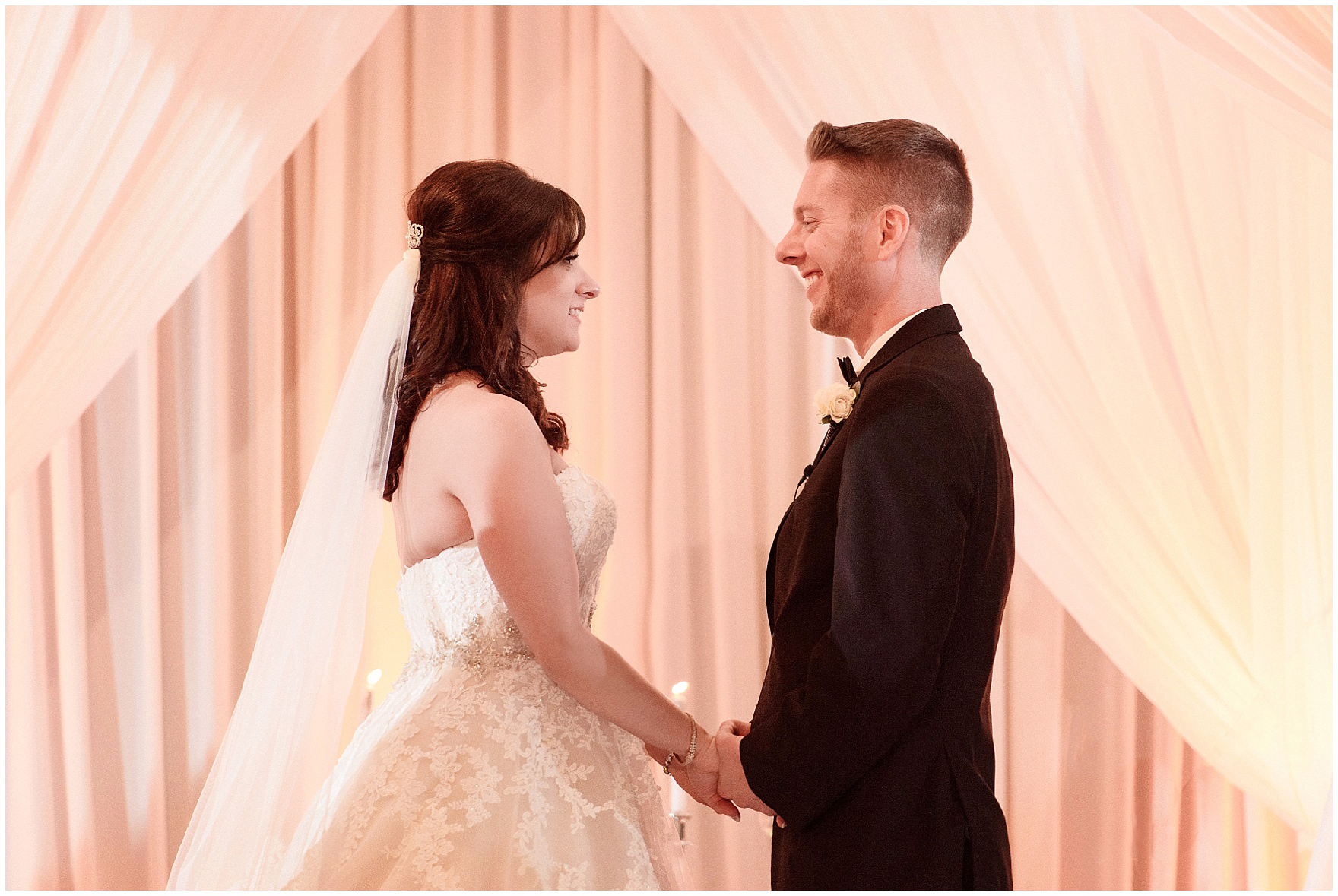 The bride and groom exchange vows at a Hotel Arista Naperville wedding.