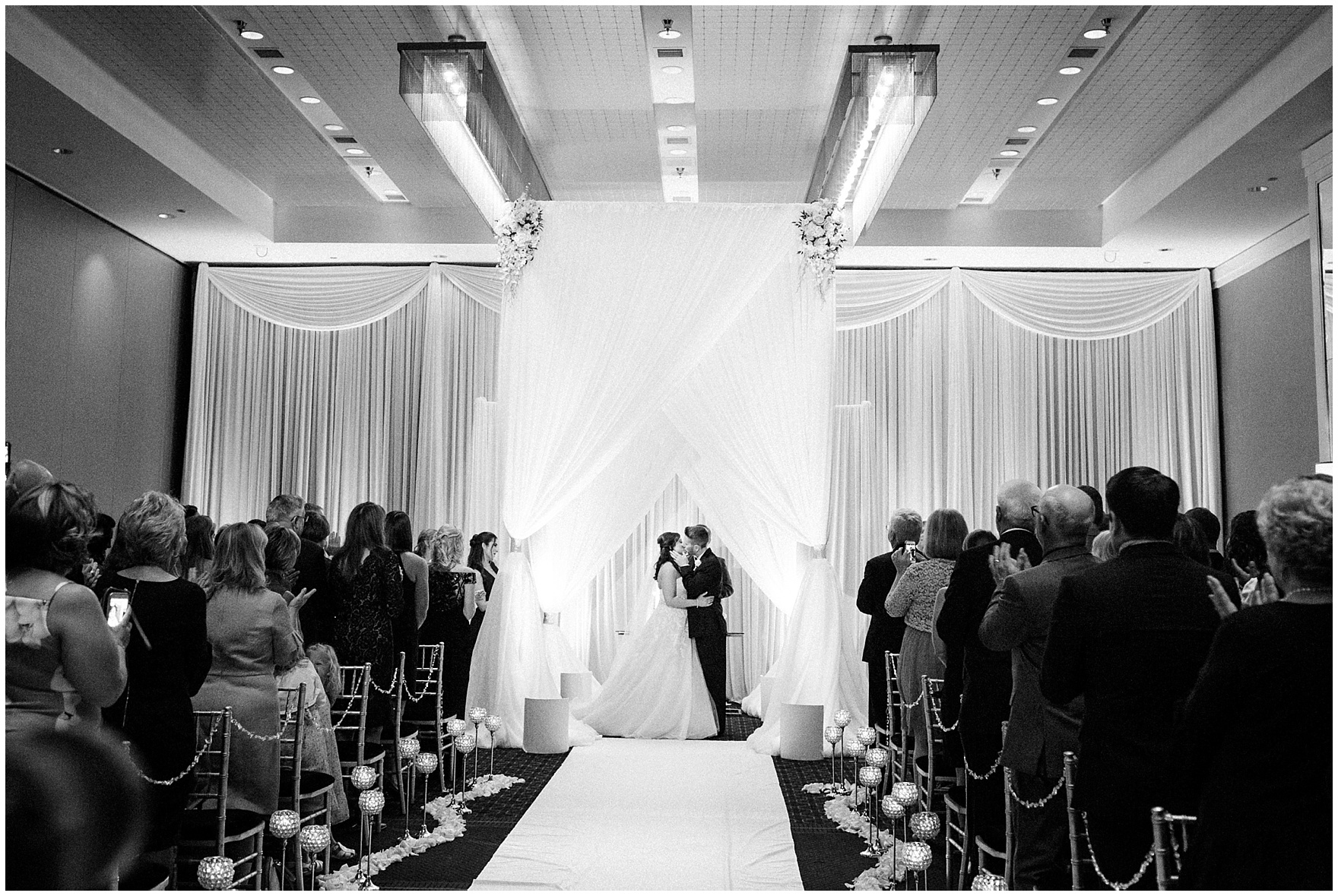 An elegant ceremony setting with candlelight and crystals for a Hotel Arista Naperville wedding.