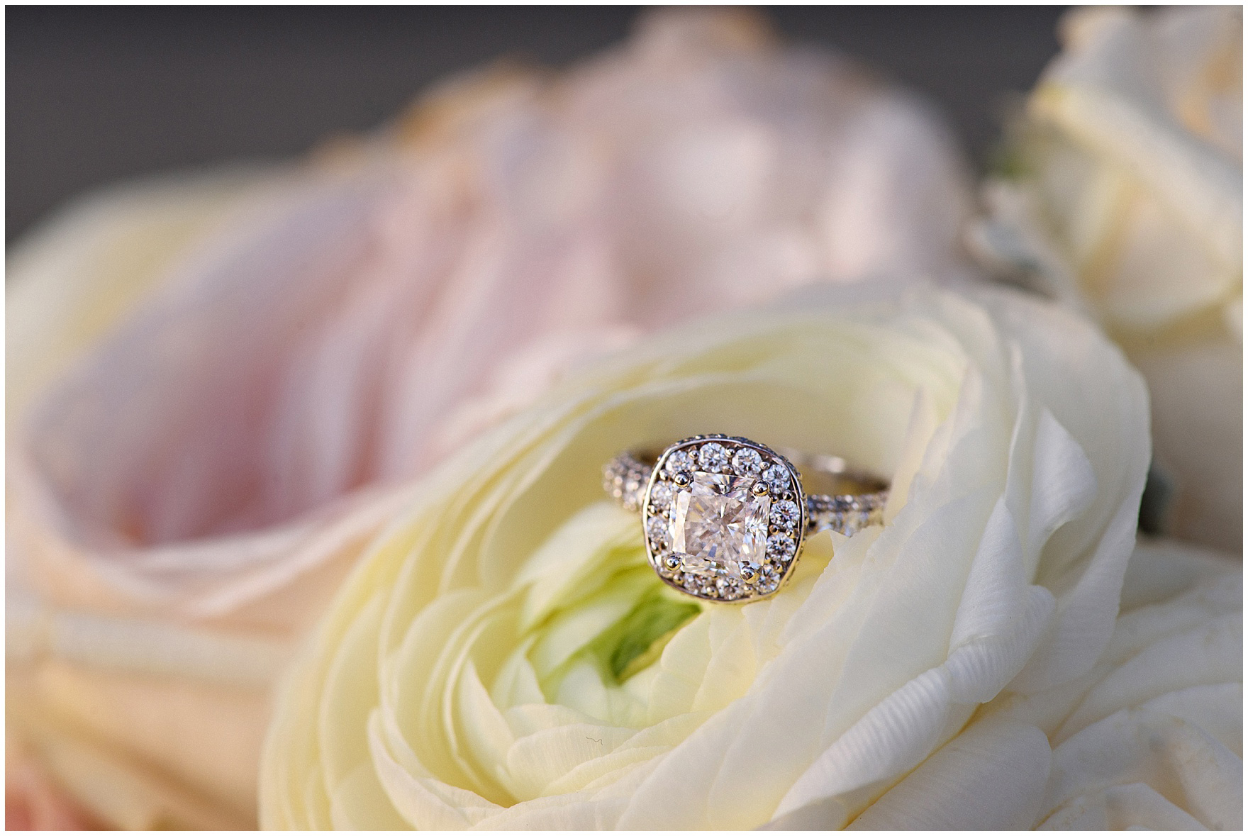 Detail of an engagement ring in a bride's bouquet during a Hotel Arista Naperville wedding.