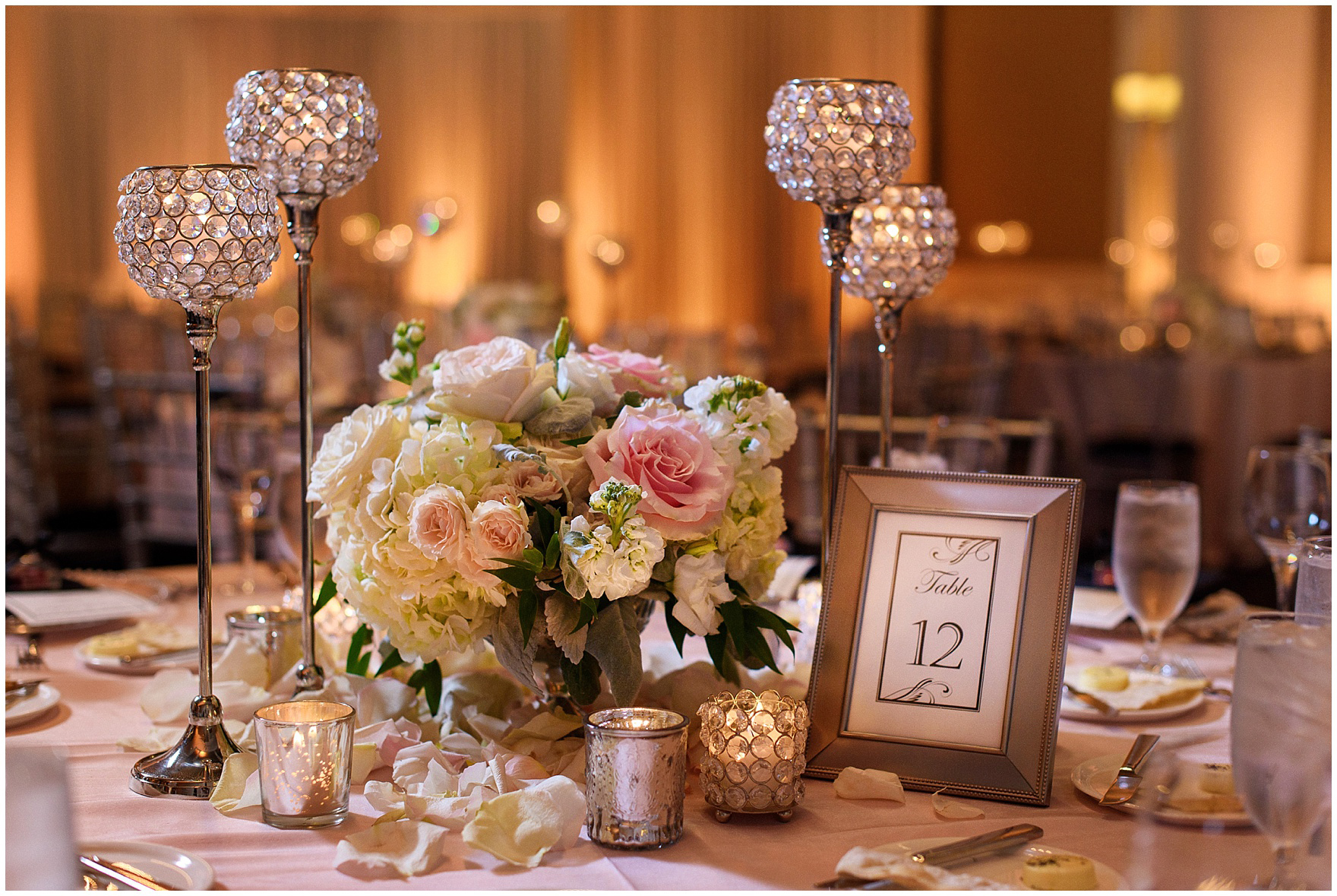 An elegant rose and gold candlelit reception for a Hotel Arista Naperville wedding.