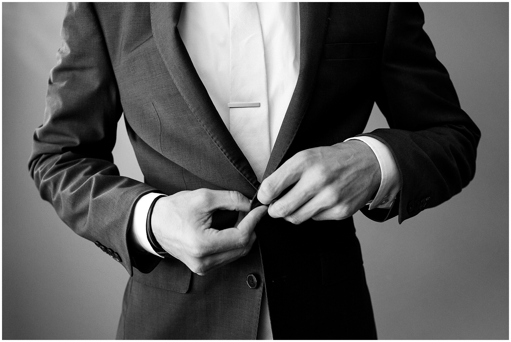 The groom gets ready for a St. Josephs Downers Grove Pinstripes Oak Brook, Illinois wedding.
