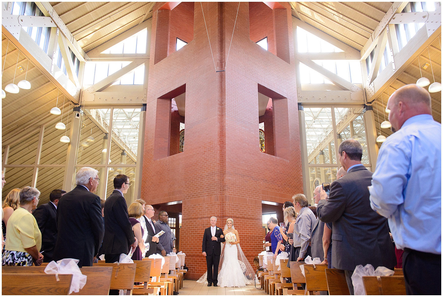 The bride and her father walk down the aisle for a St. Josephs Downers Grove Pinstripes Oak Brook, Illinois wedding.