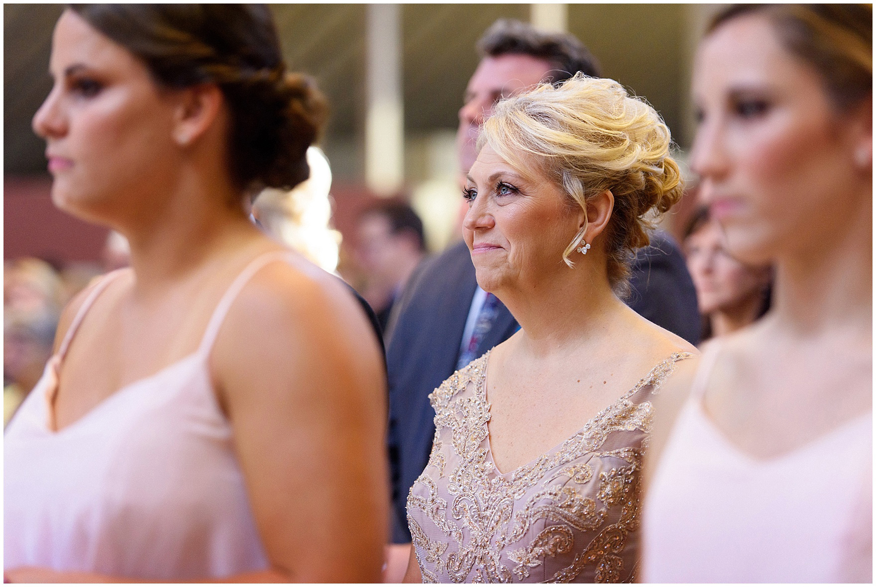 The bride's mother smiles during the ceremony for a St. Josephs Downers Grove Pinstripes Oak Brook, Illinois wedding.