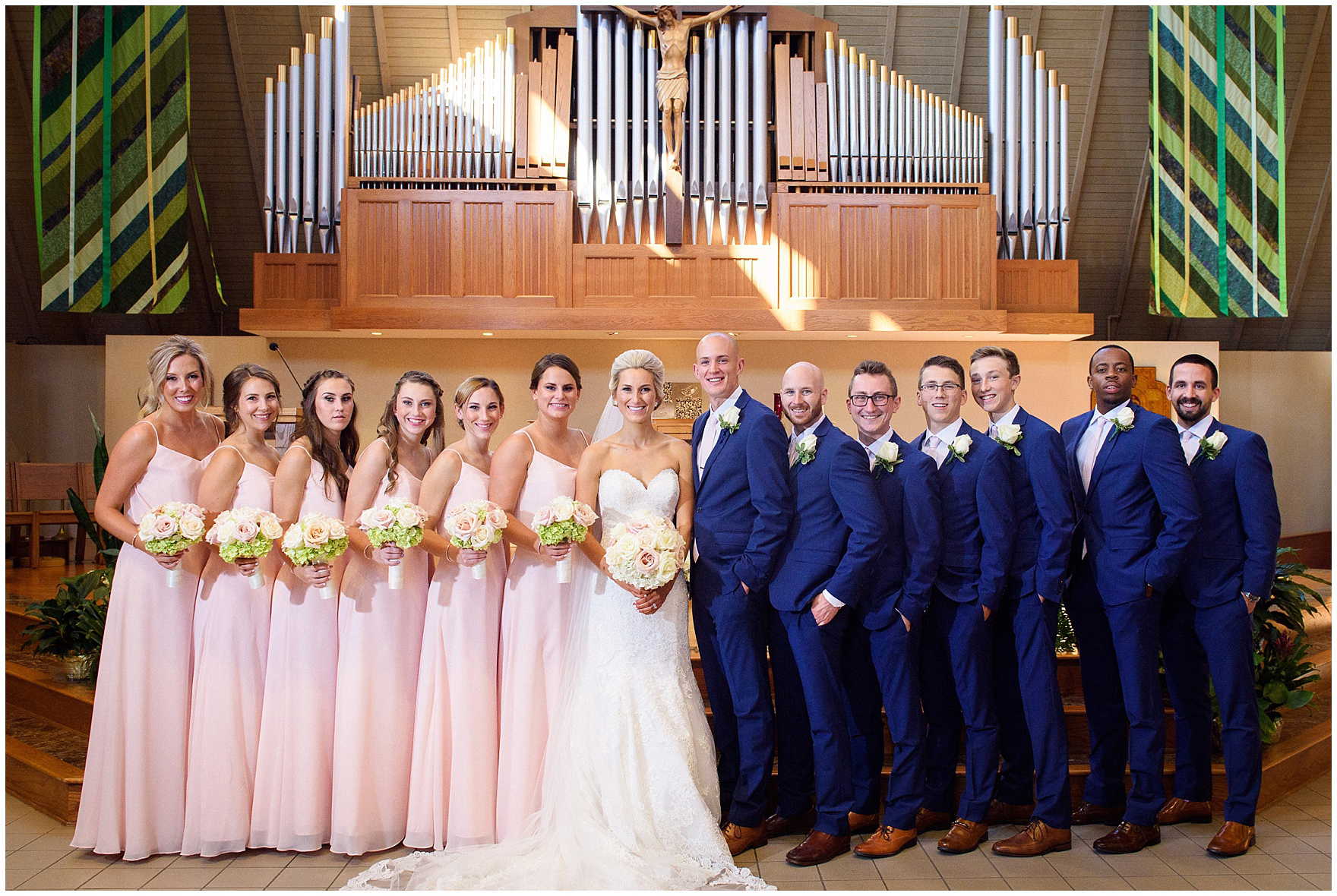 The bridal party poses at a St. Josephs Downers Grove Pinstripes Oak Brook, Illinois wedding.