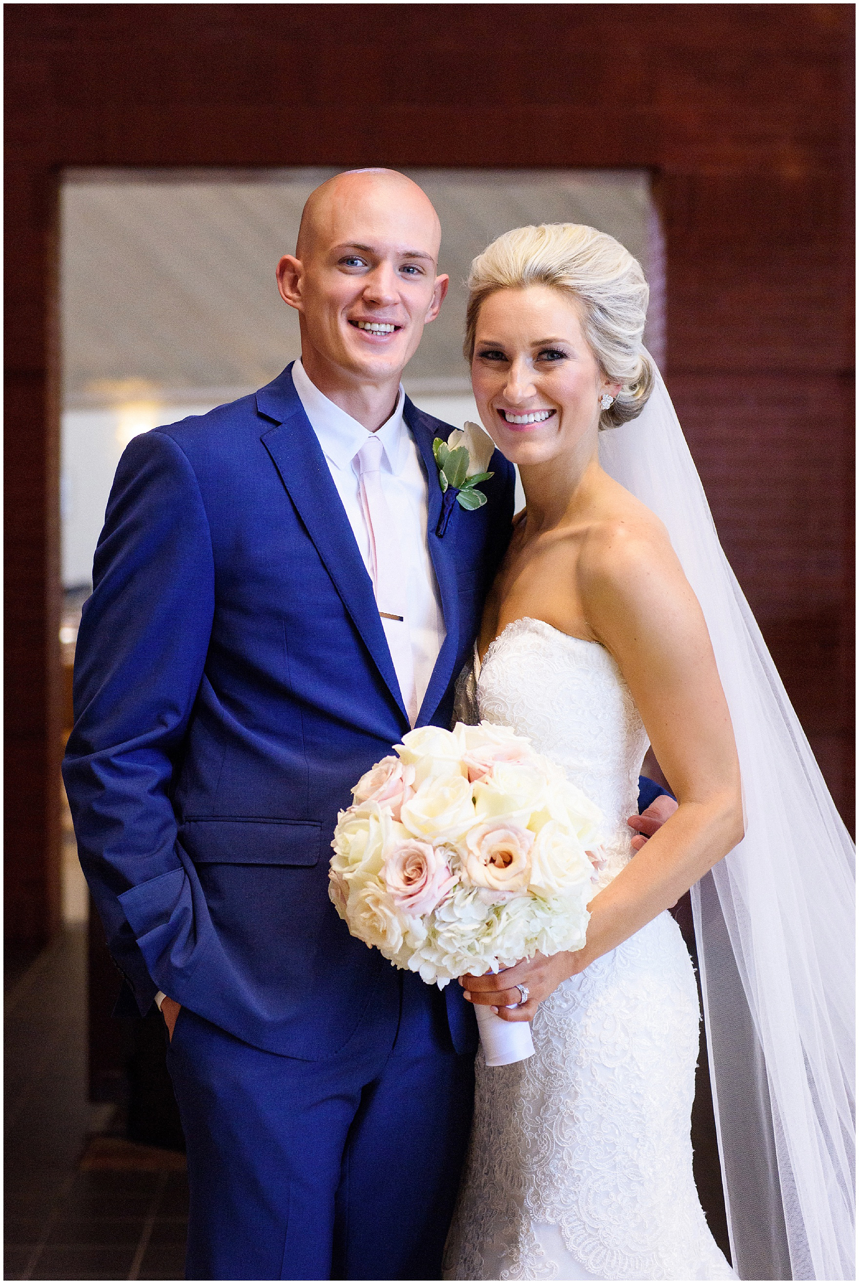 The bride and groom pose after the ceremony for a St. Josephs Downers Grove Pinstripes Oak Brook, Illinois wedding.