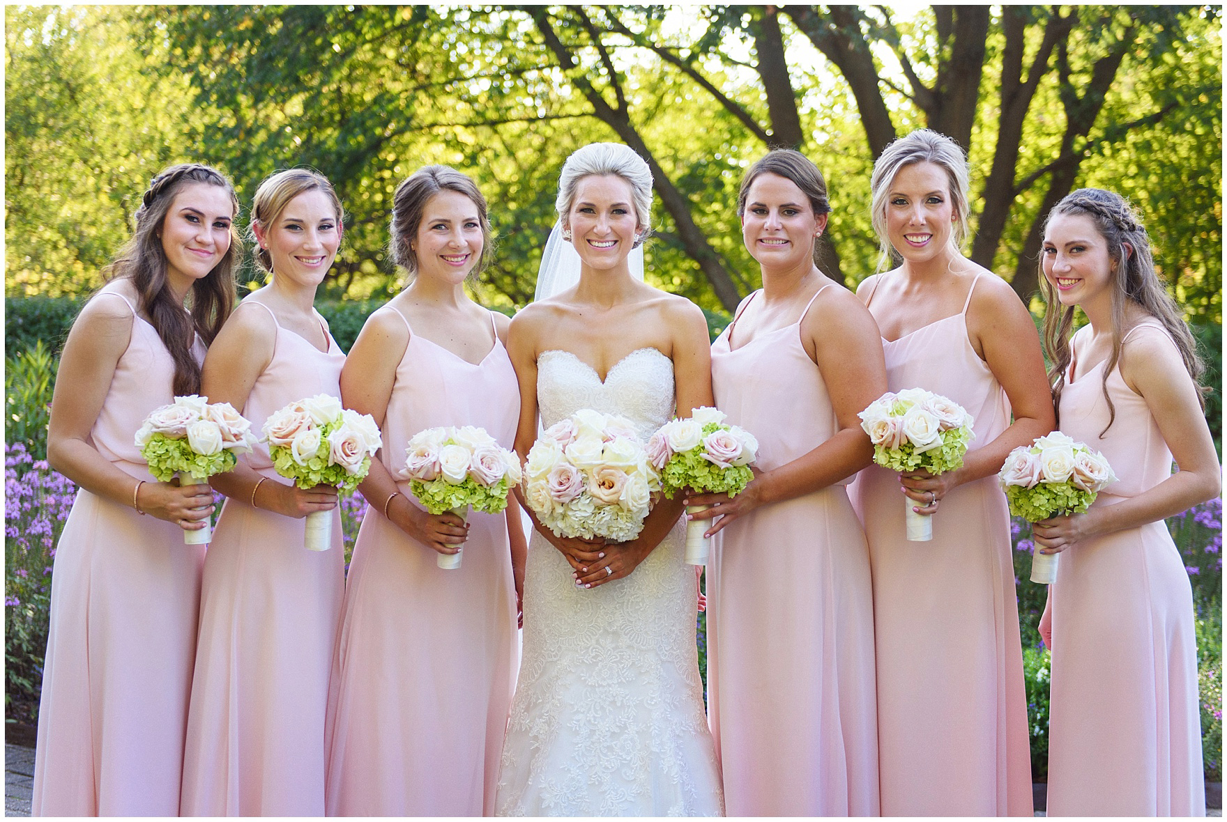 The bridesmaids pose for portraits at Cantigny Park for a St. Josephs Downers Grove Pinstripes Oak Brook, Illinois wedding.