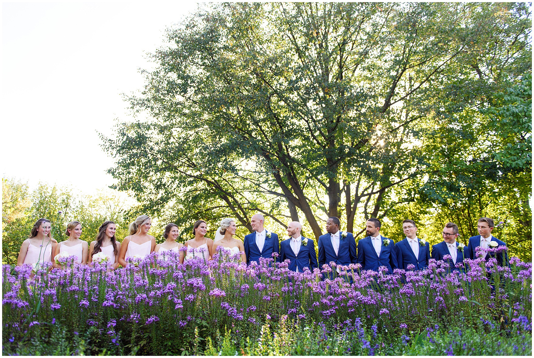 The bridal party poses for portraits at Cantigny Park for a St. Josephs Downers Grove Pinstripes Oak Brook, Illinois wedding.