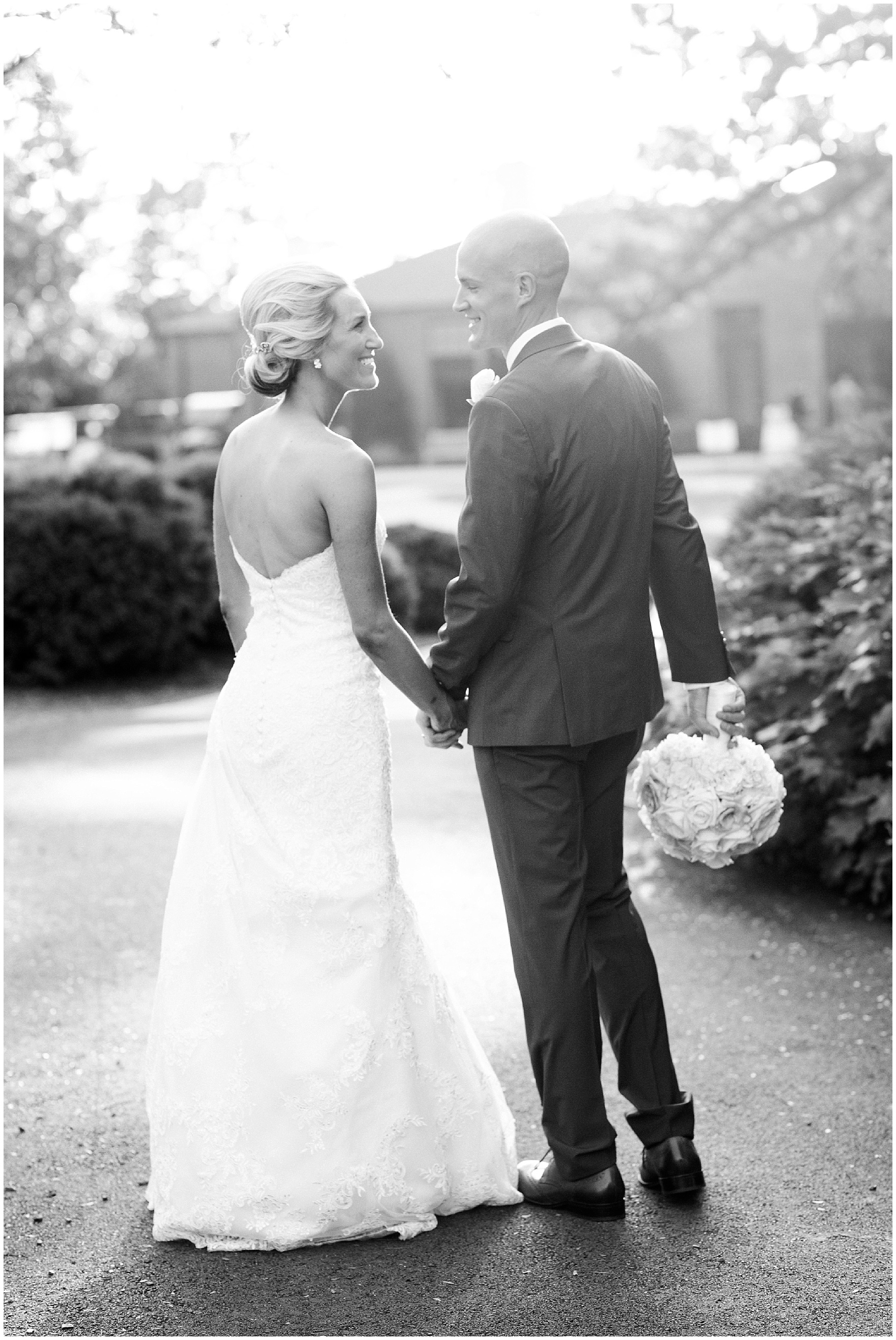 The bride and groom pose for portraits at Cantigny Park for a St. Josephs Downers Grove Pinstripes Oak Brook, Illinois wedding.