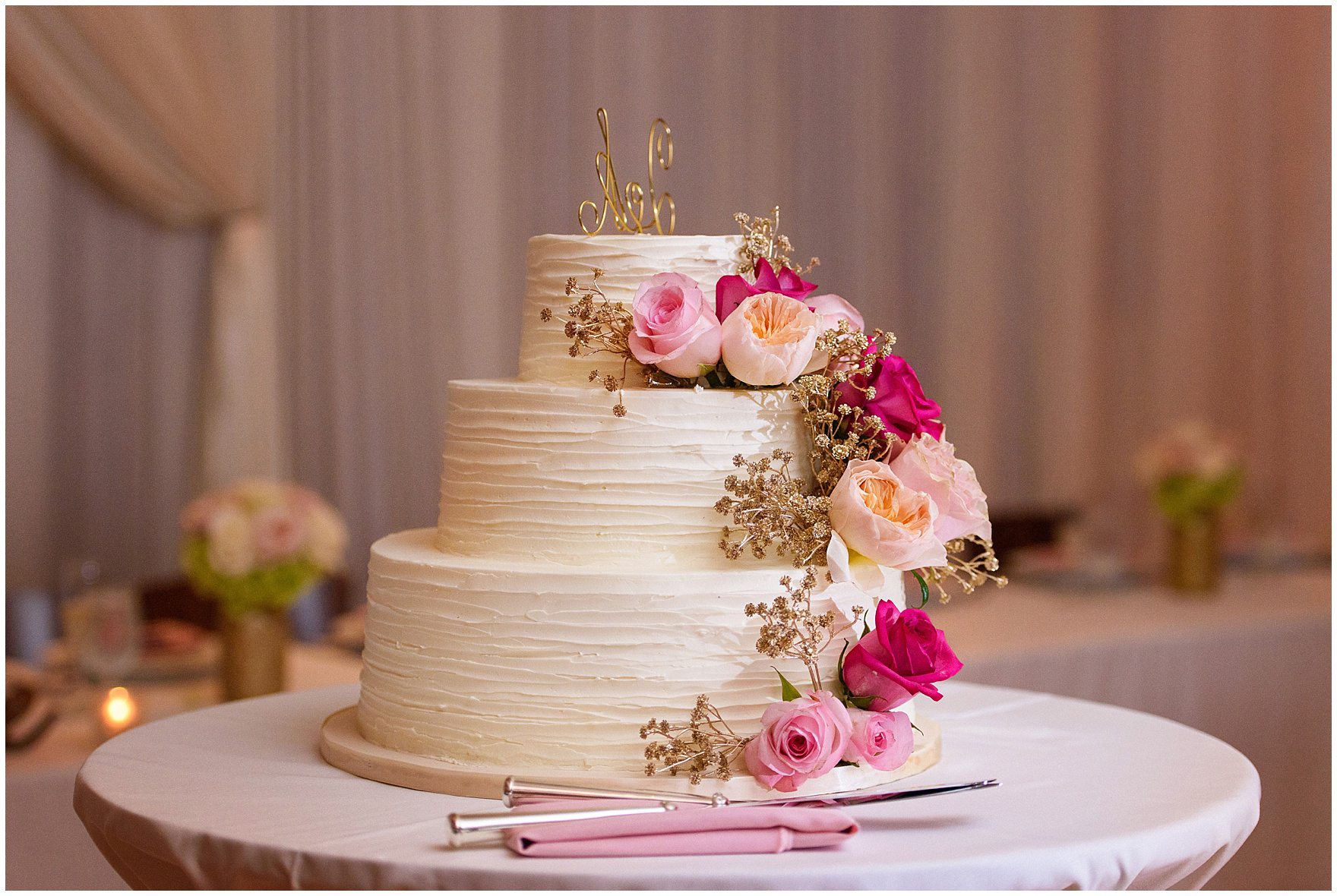 Reception decor including a wedding cake with pink roses for a St. Josephs Downers Grove Pinstripes Oak Brook, Illinois wedding.