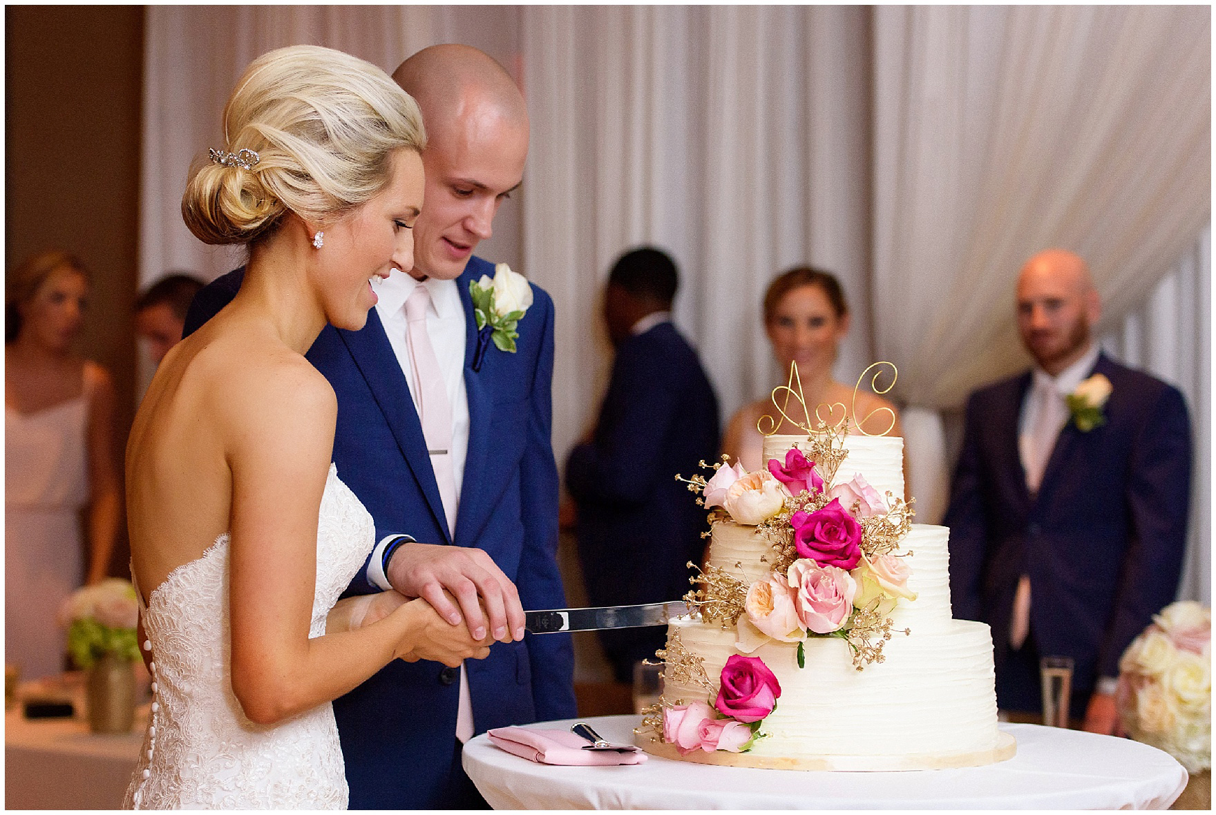The bride and groom cut their cake for a St. Josephs Downers Grove Pinstripes Oak Brook, Illinois wedding.
