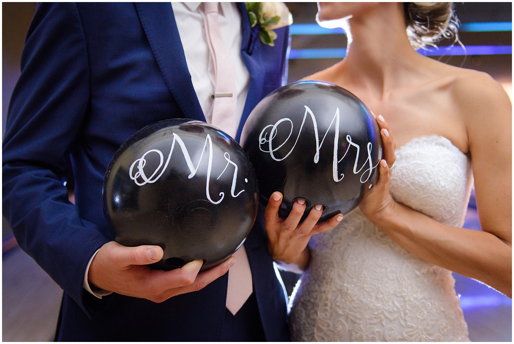 The bride and groom pose in the bowling alley for a St. Josephs Downers Grove Pinstripes Oak Brook, Illinois wedding.