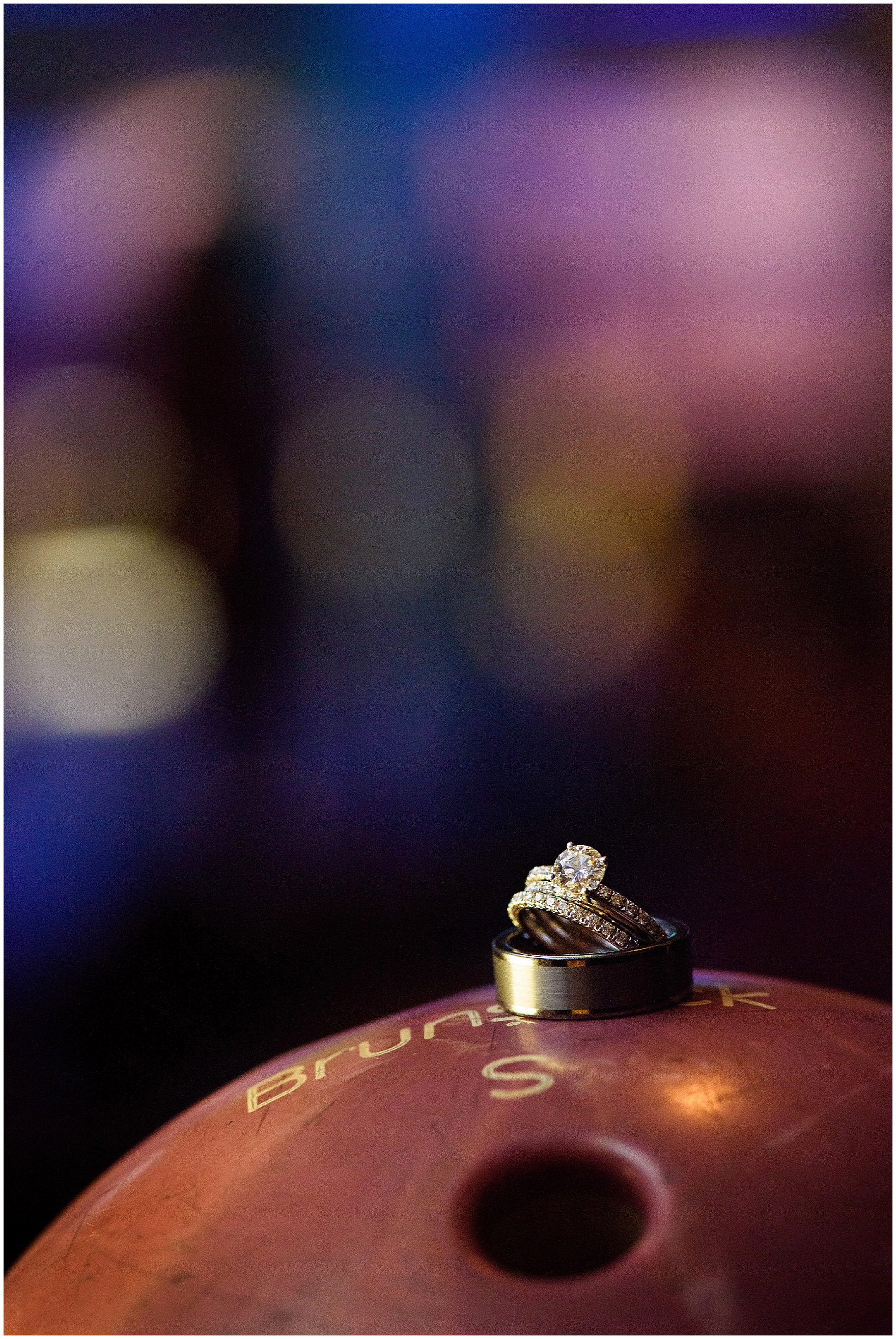 A detail shot of wedding rings and engagement ring on a bowling ball for a St. Josephs Downers Grove Pinstripes Oak Brook, Illinois wedding.