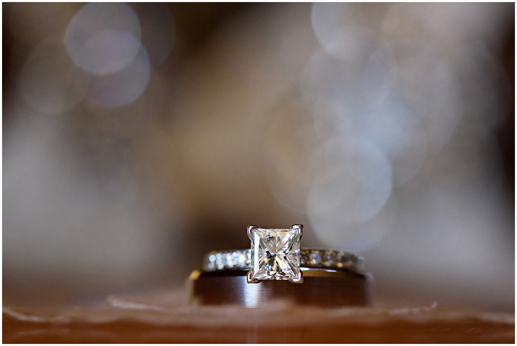 A detail shot of a diamond engagement ring with a wedding band before a Glen Club Glenview Illinois wedding.