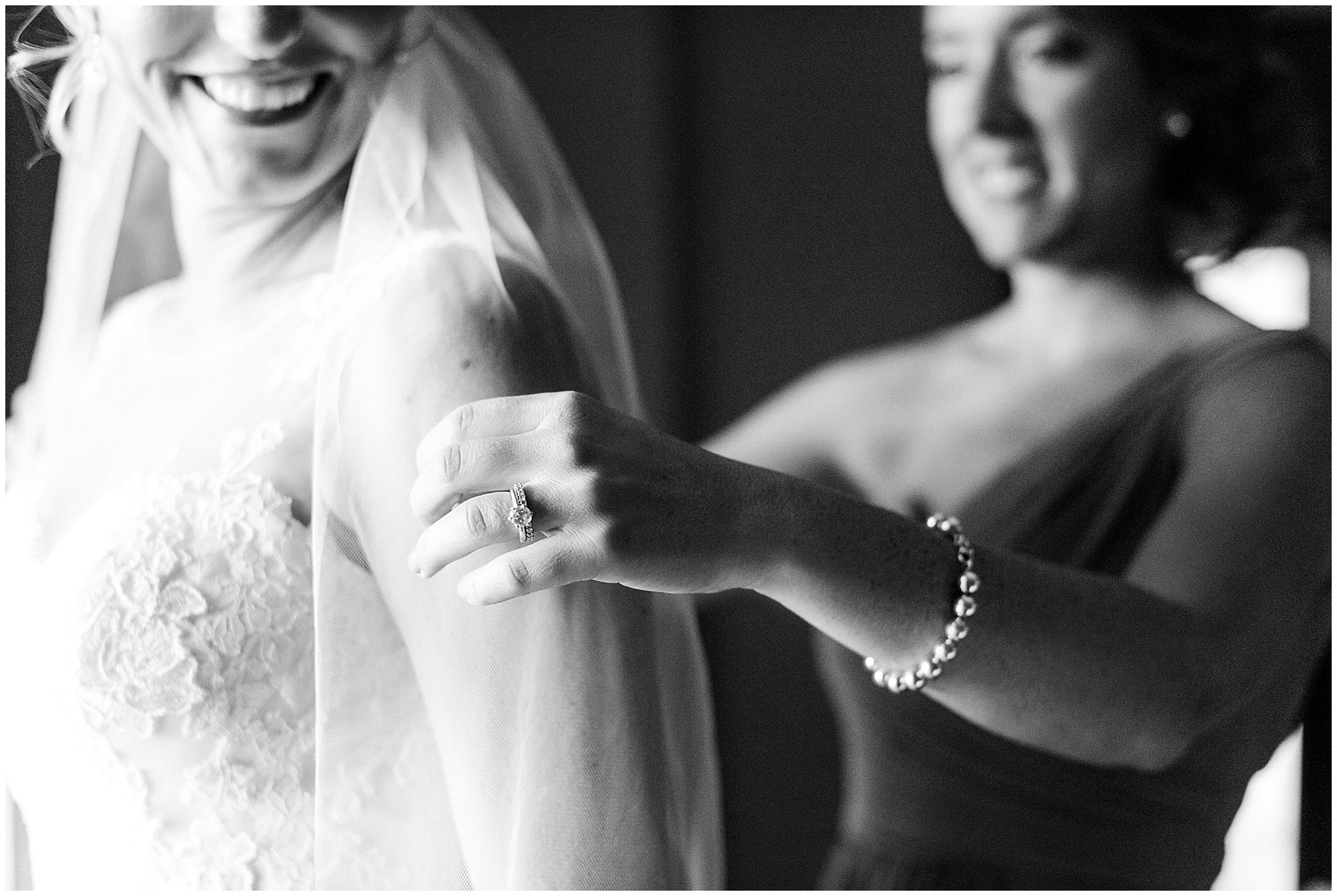 The maid of honor adjusts the bride's veil before a Glen Club Glenview Illinois wedding.